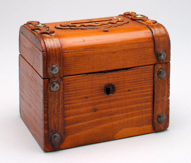 wood rectangular box with wood bands and metal studs; top opens; coin slot in top; keyhole in one side