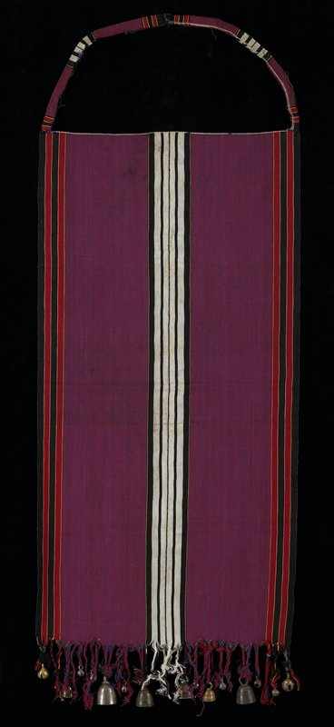 """purple apron with vertical balck and white stripes in center and red and black stripes on side edges; bottom has fringes with six bells (silver-like) and ten little """"cow bells"""" attached; neck strap, but no ties; fringes are red, blue, purple, black and white"""