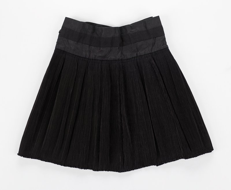 dark indigo; wrap-around; tightly pleated, with pleats sewn down at hem; undecorated
