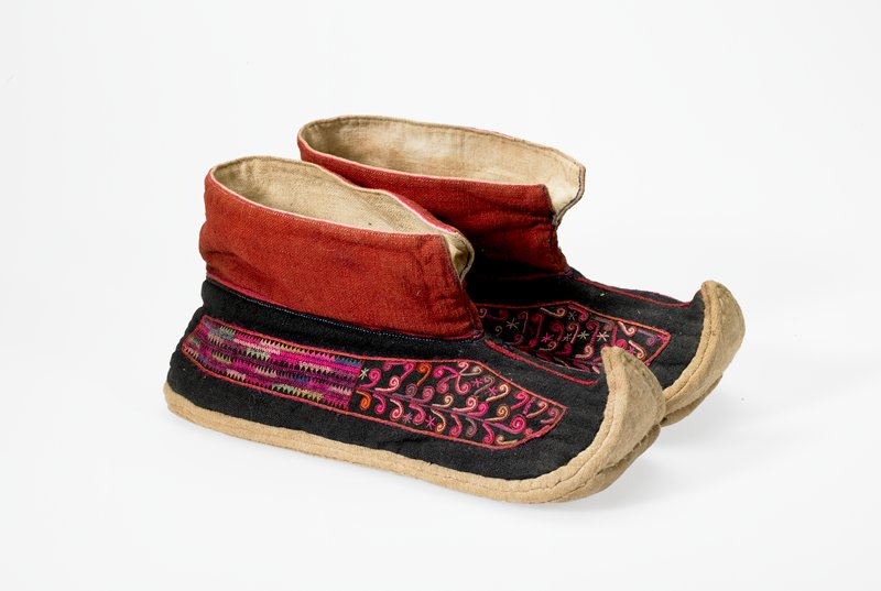 beige, black and rust shoes with pointed and upturned toes; embroidered with cane-like and flame stitched motifs on both sides in many colors