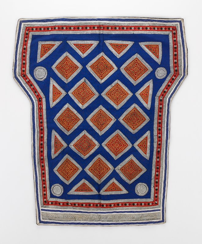 batik squares, diamonds and circles appliqued on blue ground with embroidered red and gold in continuous geometric pattern; border has center red and black embroidered stip with batik borders; no evidence of ties; black lining