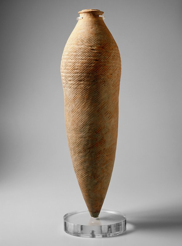 tall, thin jar with pointed lower end, small mouth and very short neck; decorated with incised diagonal lines