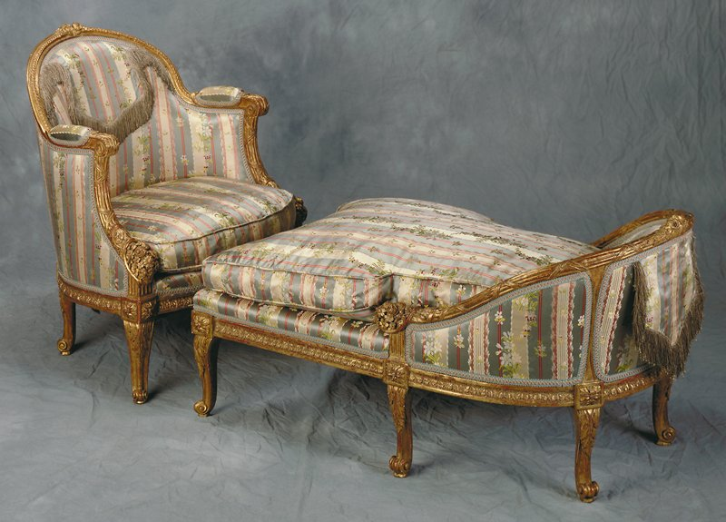 with arched, padded back within molded frame crisply carved with twin rose blossoms, summer flowers and guilloche, with padded acanthus-carved scroll arms above incurved supports carved as entwined reeded cornucopiae with crisp floral bouquets; the loose cushion seat within molded ancanthus - carved seat rail, on short cabriole legs haeded by paterae and acanthus, ending in scroll toes; upholstered in floral striped silk.