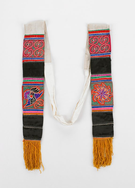 "white cotton; embroidered ends 16"" long with 4 1/2"" gold fringe; embroidered sectoins have 2 black strips separating birds and flowers embroidered on applique; red, blue, green, pink"