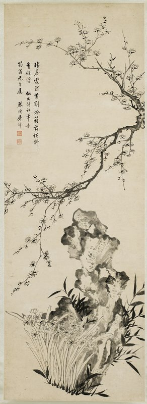 branch with blossoms extending toward left from right edge at top; irregularly-shaped rock in LRC with flowers in front
