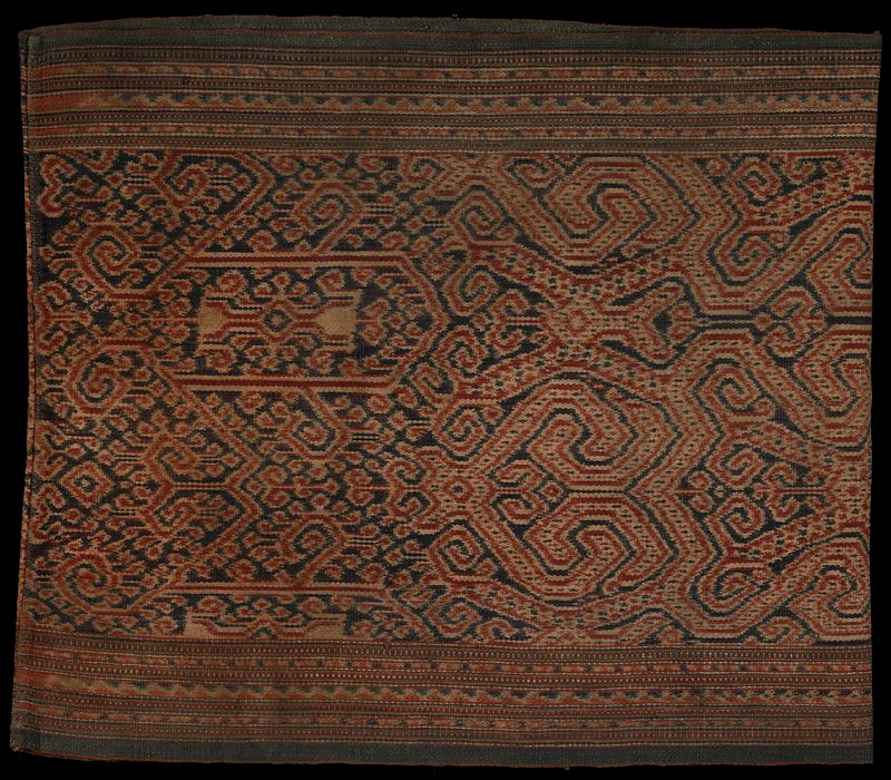 brown with tan, rust and cream; striped designs at top and bottom; curvalinear motifs at center; straight; tube-style