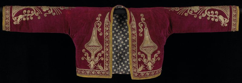 "wine velvet jacket with print lining; front panels embroidered as well as top of sleeves, in gold metallic design; 1/2"" gold tape around all edges"