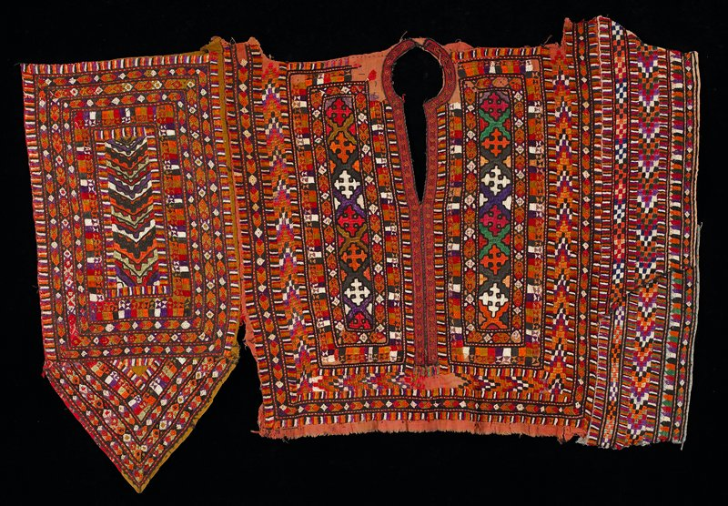 keyhole neckline; totally embroidered in geometric designs; flat piece; PL has 2 overlapping sections; PR section comes to point; orange and multicolor; unlined