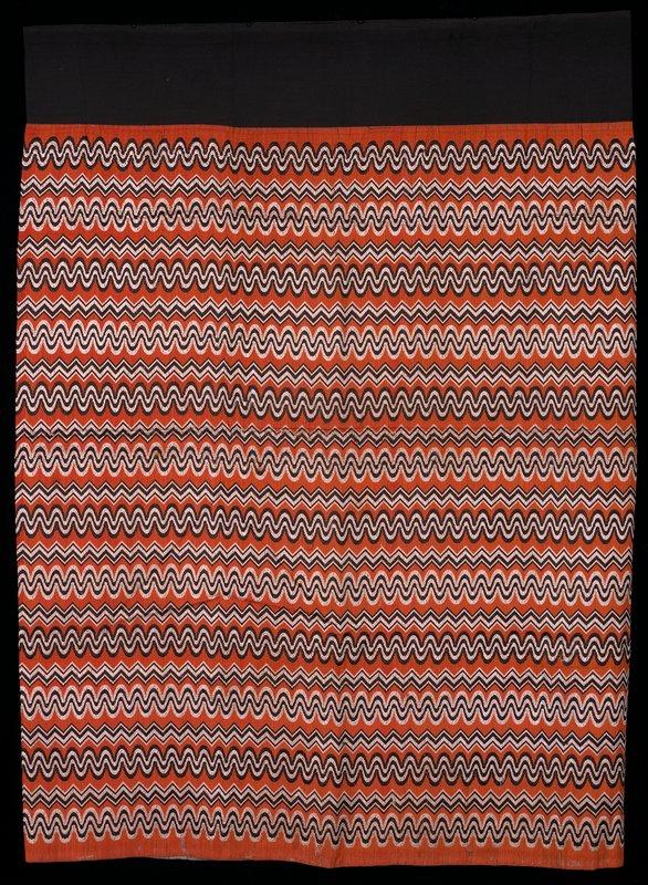luntaya style, black waist band; black and white woven patterns on dull orange