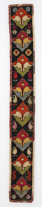 Warp-twined (LM) band fragments, Striped lining.Overall cross stitch embroidery on a cotton ground. An applied silk band forms the edging. There is a striped silk/cotton fabric backing. Black, red, green, yellows dominate. Horizontal join at center.