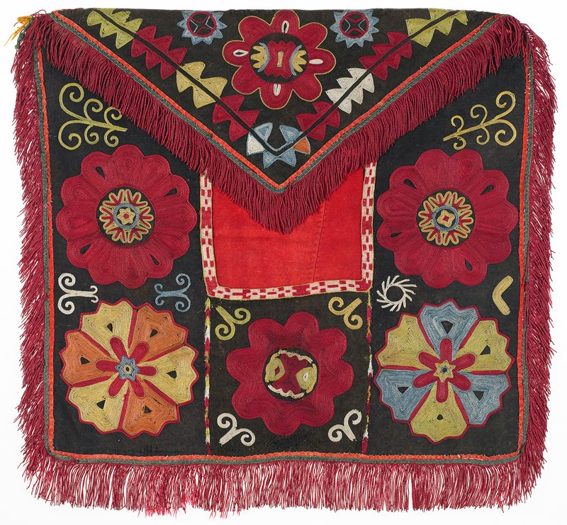 Fringe with warp-twined heading, embroidered and cloth bands, Pieced, printed lining. Red and black plain weave wool ground in the visible area; under the flap the ground is pieced from printed cotton fabrics. The embroidery is worked in polychrome silk threads. There is an edge binding of red cotton fabric. The applied fringe is silk. There is a backing of red printed cotton fabric.