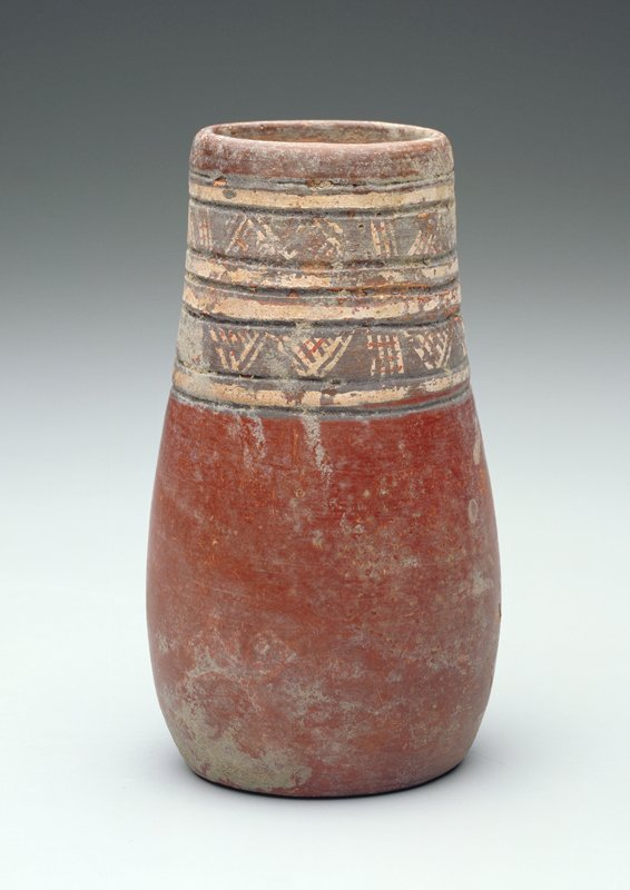 Small cup with slight flare near base; red body with decorations around mouth incised lines and hatched designs in brown and tan