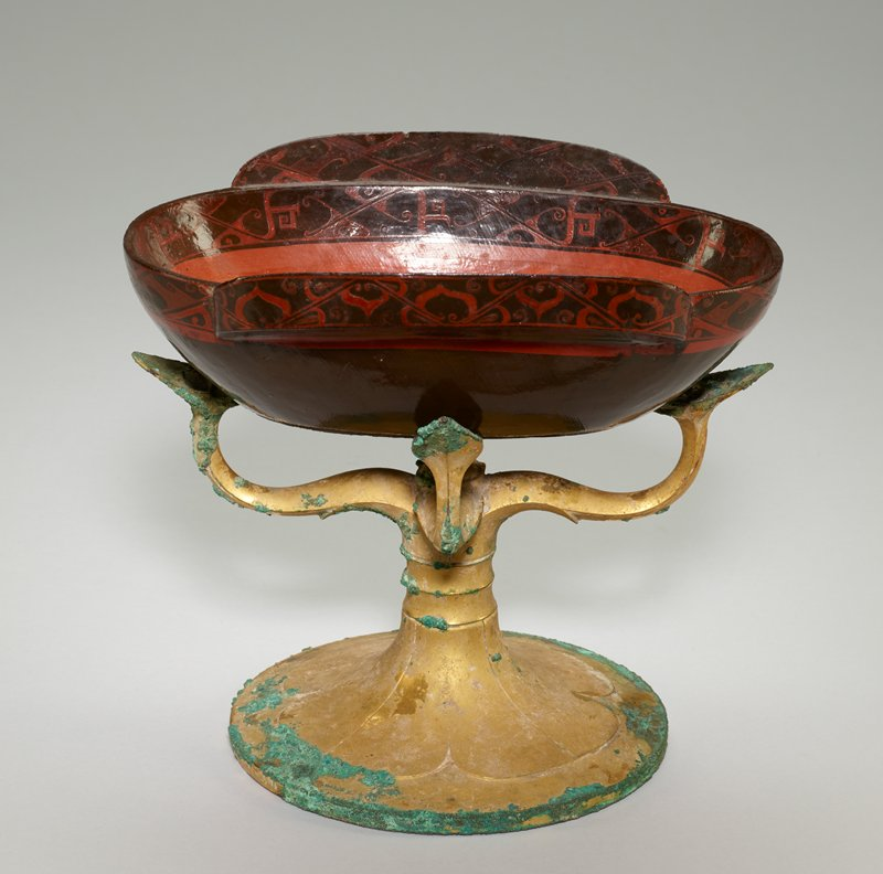 gold patina; four branching arms of organic design; flower motif on base