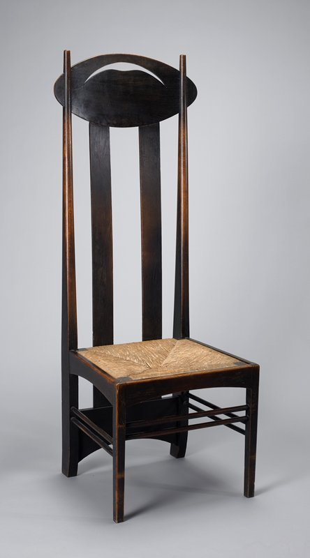 low rush woven seat; very tall back with two tapering side pieces and two wide vertical slats, all connected to ovoid piece at top with crescent cut-out; thick back support between back legs