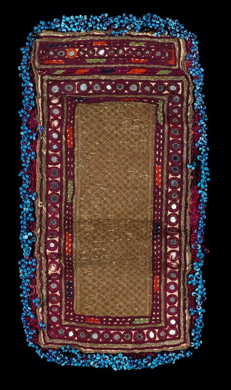 blue, maroon, white metal; satin stitch embroidery; metallic threads in diamond pattern surrounded by chain stitch and shi-sha mirrors; completely edged in blue glass bead fringe; bi-fold opens to reveal three pockets; same design as exterior; lined in striped cotton and in solid red cotton; some red beads edge interior pockets