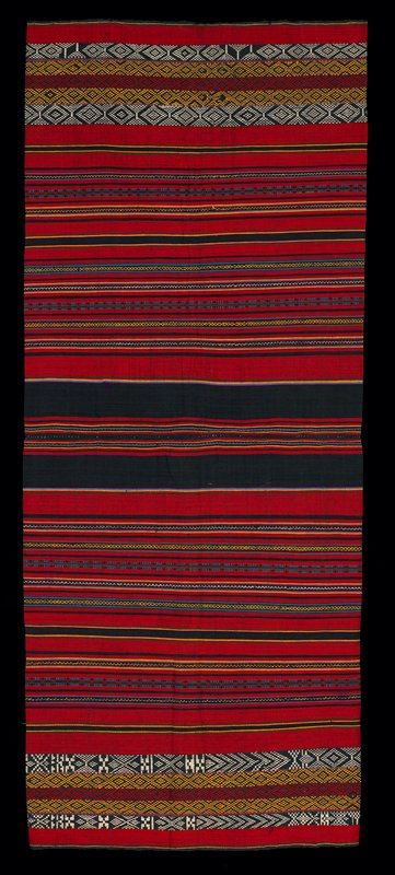 two panels stitched together, horizontally and vertically; center seam has wide navy stripes; various widths of stripes in red, yellow and white complete patterns on both panels with slight variation in blue and white stripes; very heavy