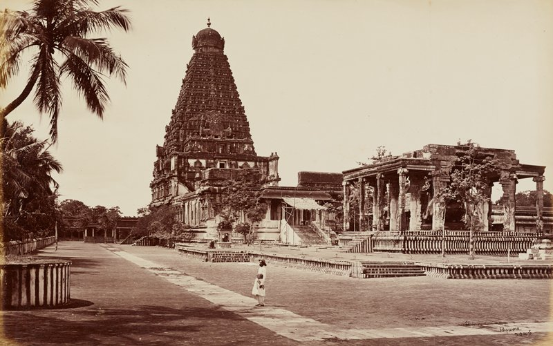 elaborate temple structure with an almost Greek style temple building to the front R side; male figure at center foreground