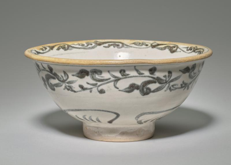blue and white; rim flares slightly outward; inner rim band of organic design; four organic designs at interior; outer flower and foliage band; four organic shapes around foot; red on bottom