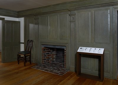 one complete wall of pine paneling consisting of four panels; first containing door; second panels; third chimney piece with fine moulding surrounding it with fluted pilasters over which are three small panels; fourth panels; dating from first half of 18th century; prov. from a house in Foxon just northeast of New Haven Conn.