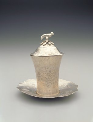 saucer decorative edge; with incised zigzags at center and alternating birds and floral arrangementts around rim; cup with lid cup has incised alternating birds and floral arrangements; lid has bird-shaped knob with 2 movable floral elements below