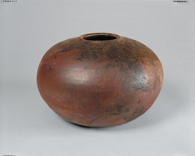 "glazed interior; dark olive, brown, and charcoal colored glaze with ochre, orange, and pink accented areas; 3 1/2"" mouth diameter with slightly raised, rolled lip; several small bumps near mouth"